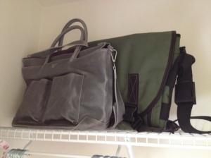 mom:dad diaper bags in closet